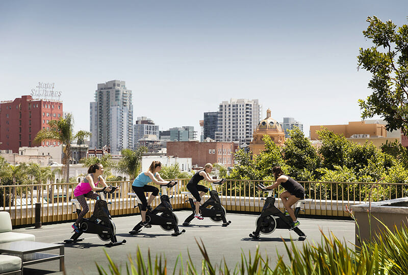 Rooftop spin class with views of downtown San Diego