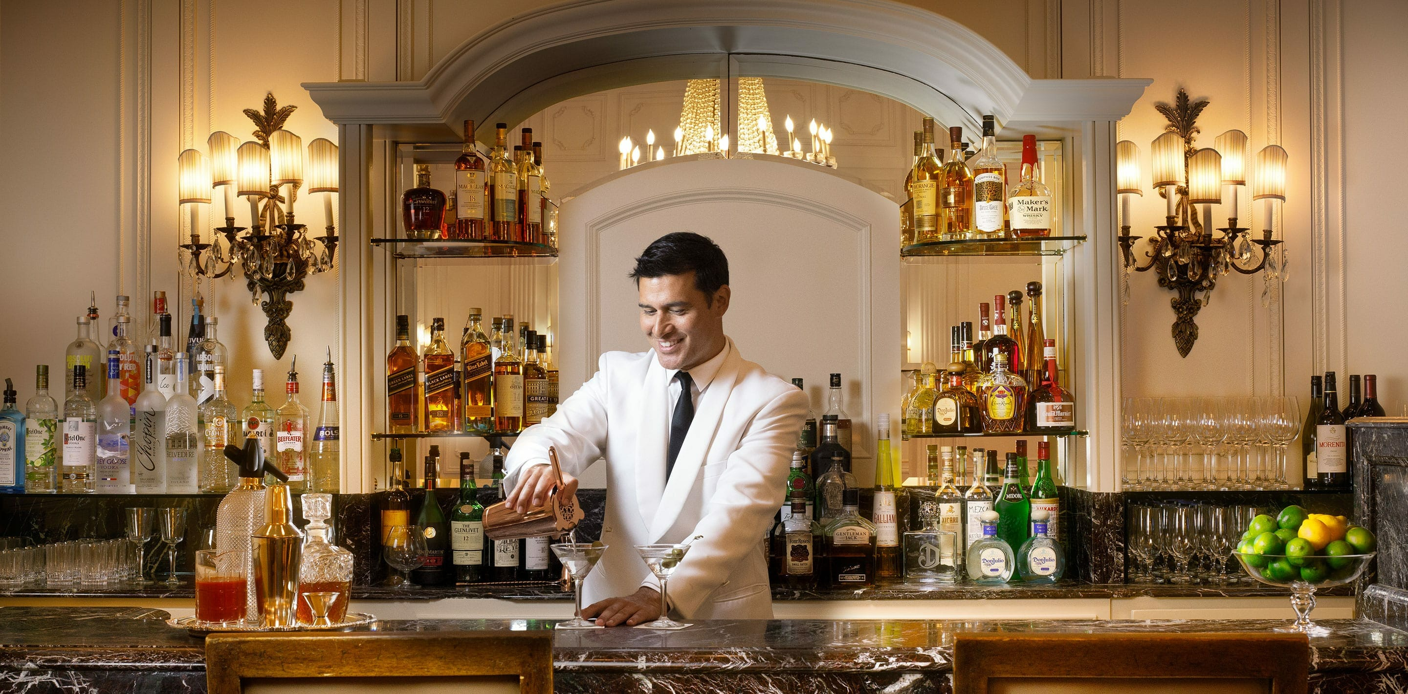 Bartender making a drink behind the counter of the Westgate Hotel Plaza Bar