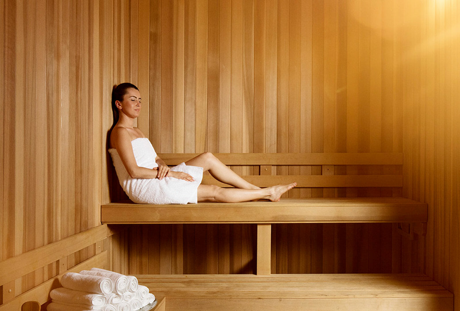 Woman relaxing in AquaVie Spa sauna