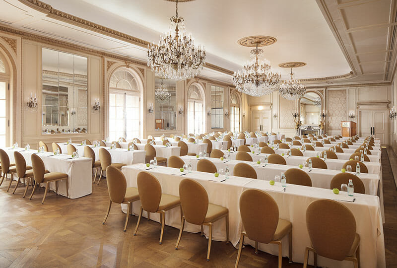 Versailles Ballroom set classroom style with green apples
