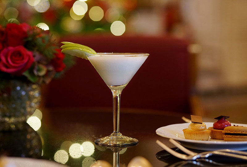 holiday cocktail with lights in background