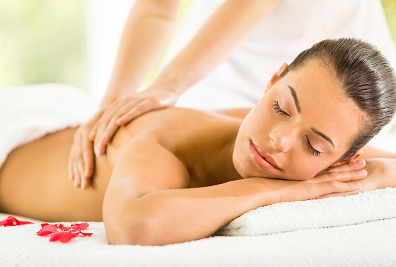 Woman enjoying back massage.