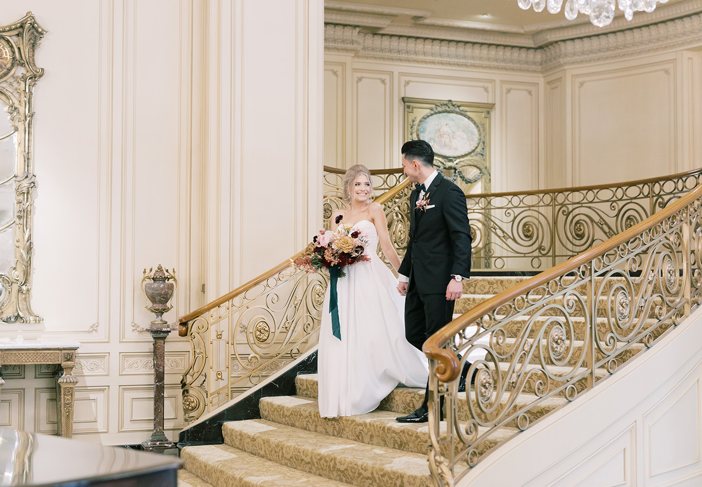 Newwlyweds on grand staircase at The Westgate Hotel
